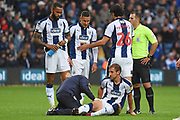 West Bromwich Albion defender Craig Dawson (25) receives treatment during the EFL Sky Bet Championship match between West Bromwich Albion and Millwall at The Hawthorns, West Bromwich, England on 22 September 2018.