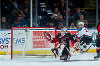 KELOWNA, CANADA - MARCH 14:  Taylor Gauthier #35 of the Prince George Cougars misses a save on a shot by Dillon Dube #19 of the Kelowna Rockets during third period on March 14, 2018 at Prospera Place in Kelowna, British Columbia, Canada.  (Photo by Marissa Baecker/Shoot the Breeze)  *** Local Caption ***