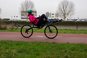 Lieke de Cock rijdt op haar trainingsfiets van Challenge. In september wil het Human Power Team Delft en Amsterdam, dat bestaat uit studenten van de TU Delft en de VU Amsterdam, tijdens de World Human Powered Speed Challenge in Nevada een poging doen het wereldrecord snelfietsen voor vrouwen te verbreken met de VeloX 8, een gestroomlijnde ligfiets. Het record is met 121,81 km/h sinds 2010 in handen van de Francaise Barbara Buatois. De Canadees Todd Reichert is de snelste man met 144,17 km/h sinds 2016.<br /> <br /> Lieke de Cock rides her training recumbent. With the VeloX 8, a special recumbent bike, the Human Power Team Delft and Amsterdam, consisting of students of the TU Delft and the VU Amsterdam, also wants to set a new woman's world record cycling in September at the World Human Powered Speed Challenge in Nevada. The current speed record is 121,81 km/h, set in 2010 by Barbara Buatois. The fastest man is Todd Reichert with 144,17 km/h.