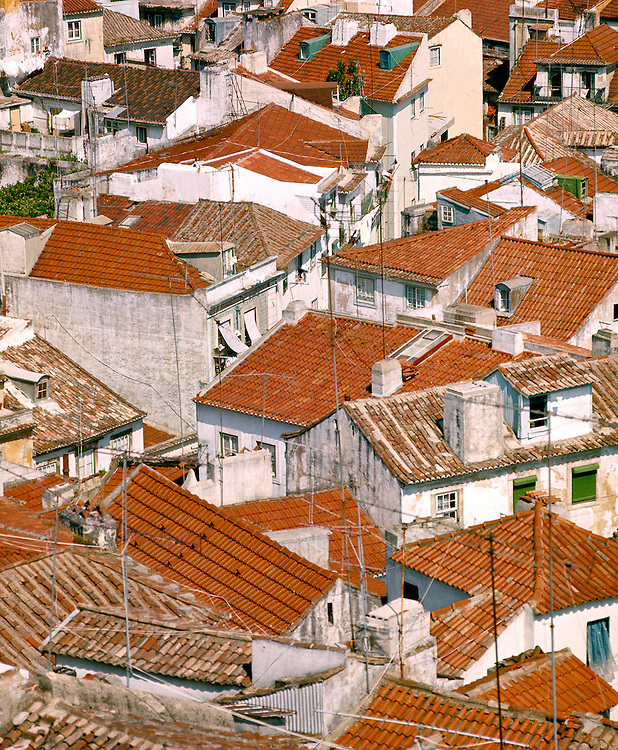 Red tiled roofs fill the frame in the old district of Lisbon, Portugal.
