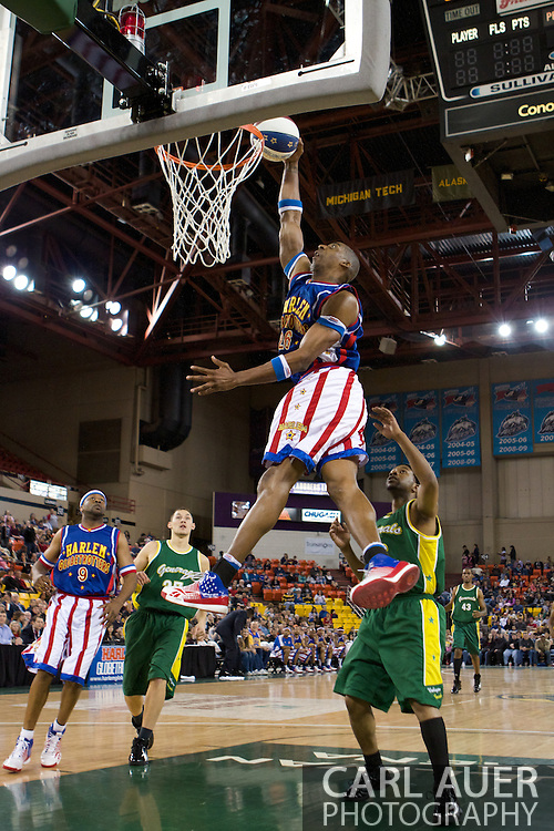 April 30th, 2010 - Anchorage, Alaska: Harlem Globetrotter Hi-Lite Bruton demonstrates his dunking ability against the Washington Generals with a baseline windmill dunk.