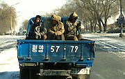 Pyongyang, North Korea.<br />Workers ride in the cold through the frozen streets of Pyongyang<br /><br />Picture Credit: Dermot Tatlow