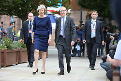 © Licensed to London News Pictures. 04/10/2017. Manchester, UK. Theresa May & husband in Manchester this morning ahead of Her speech on the third & final day of the Conservative Party Conference today in Manchester. Photo credit: Andrew McCaren/LNP