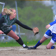 "May 8, 2009 -- BATH, Maine. Morse's Libby Williams is tagged out at in a steal attempt at third early in the game on Friday afternoon. Morse rebounded under pitching by Megan Hennessey and good base running throughout the game. The girls won their second in a row by blanking Leavitt 4-0 at home on Friday afternoon -- under a passing shower and a rainbow. Coach Will Laffely said, ""They're a good group. They play practice hard and play hard."" He noted that although they are 2-5 overall, they have a squad with no seniors and several returning sophomores and juniors as starters including junior pitcher, Megan Hennessey. He thinks they will be stronger in the second half of the season. Photo by Roger S. Duncan."