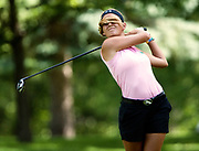Haily Abel is whipped in the face by her hair after teeing off on the eleventh hole during the North Dakota state women's stroke play tournament at Fargo's Edgewood golf course on Tuesday, July 21, 2015.<br /> Nick Wagner / The Forum