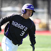 Geoff Seto #3 of the Niagara Purple Eagles runs to first base during the game at Friedman Diamond on March 16, 2014 in Brookline, Massachusetts. (Photo by Elan Kawesch)