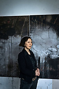 Frankfurt | 08 January 2018<br /> <br /> Painter Kejoo Park at her studio in Frankfurt, Germany with one of her paintings.<br /> <br /> photo &copy; peter-juelich.com