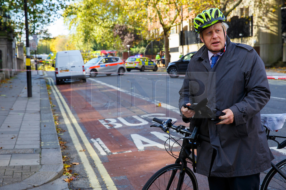 © Licensed to London News Pictures. 21/10/2014. LONDON, UK. Mayor of London, Boris Johnson happens to be passing by the area visits the scene where a woman has been killed by a tree and wall which were blown down by high winds opposite Knightsbridge Barracks in west London. Photo credit : Tolga Akmen/LNP