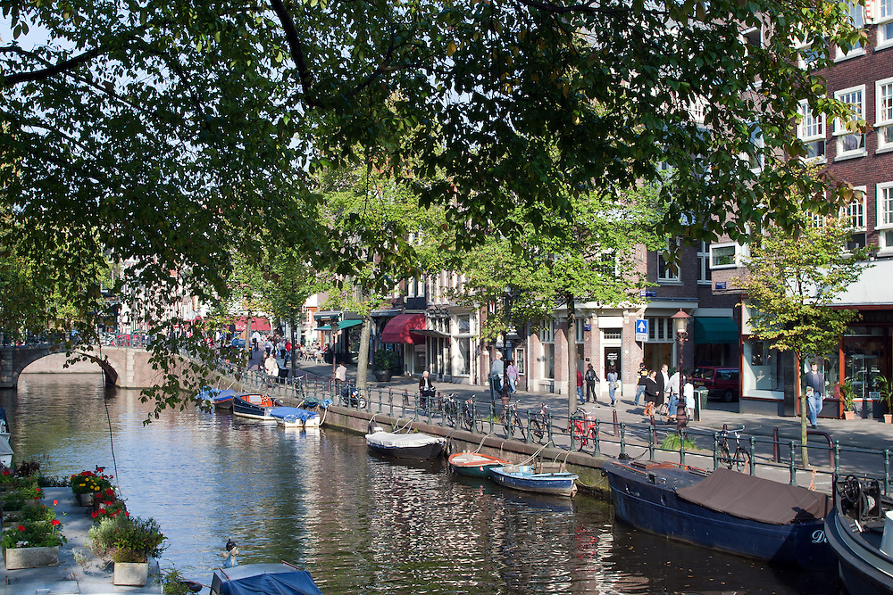 """One of the prettiest Amsterdam canals is the Spiegelgracht, near the Rijksmuseum.  Shoppers find small antiques stores, boutiques, tiny cafes, and art galleries -- perfect for an afternoon stroll. Along with the narrow street called Nieuwe Spiegelstraat, the area is known as the """"Spiegelkwartier."""" ."""