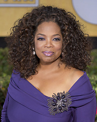 February 7, 2020, Los Angeles, CALIFORNIA, USA: Oprah Winfrey speaks on the backlash against Gayle King for bringing up Kobe Bryant's Rape Case during an interview with Lisa Leslie. FILE PHOTO: Oprah Windfrey  at the red carpet of the 20th Annual Screen Actors Guild Awards held at the Shrine Auditorium in Los Angeles, California, Sunday, January 18, 2014. JAVIER ROJAS/PI (Credit Image: © Prensa Internacional via ZUMA Wire)
