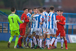ASHTON-UNDER-LYNE, ENGLAND - Sunday, February 12, 2017: Huddersfield Town's Jamie Spence His restrained by his team-mate after clashing with Liverpool players before being sent off during the FA Premier League Cup Group G match at Tameside Stadium. (Pic by David Rawcliffe/Propaganda)