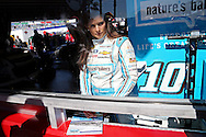 Feb 13, 2016; Daytona Beach, FL, USA; NASCAR Sprint Cup Series driver Danica Patrick (10) signs autographs through her garage window during practice for the Daytona 500 at Daytona International Speedway. Mandatory Credit: Peter Casey-USA TODAY Sports