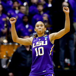 Mar 26, 2013; Baton Rouge, LA, USA; LSU Tigers guard Adrienne Webb (10) celebrates a win over the against the Penn State Lady Lions in the second round of the 2013 NCAA womens basketball tournament at Pete Maravich Assembly Center. LSU defeated Penn State 71-66. Mandatory Credit: Derick E. Hingle-USA TODAY Sports