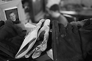 """Gloves are laid out by the door. """"I have one pair for carrying the metal, another pair for fixing the truck, and another pair for driving the truck. (© Matt Wright 2011)"""
