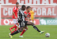 Portugal, FUNCHAL :Nacional´s Egypt midfielder Aly Ghazal  vies with Benfica's Brazilian forward Lima during the Portuguese league football match CD Nacional vs Benfica at the Madeira stadium in Funchal on November 09, 2014.  AFP PHOTO / GREGORIO CUNHA