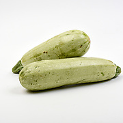 Fresh and organic courgette on white background