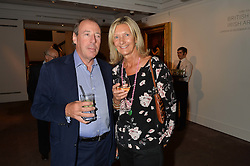 MICHAEL SAMUEL and CATHERINE SOAMES at a reception to celebrate the publication of Hockney - A Pilgrim's Progress by Christopher Simon Sykes held at Sotheby's, New Bond Street, London on 30th September 2014.