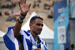 November 12, 2017 - Athens, Attica, Greece - Merousis Hristoforos covered with the greek flag at the 35th Athens Classic Marathon in Athens, Greece, November 12, 2017. (Credit Image: © Giorgos Georgiou/NurPhoto via ZUMA Press)