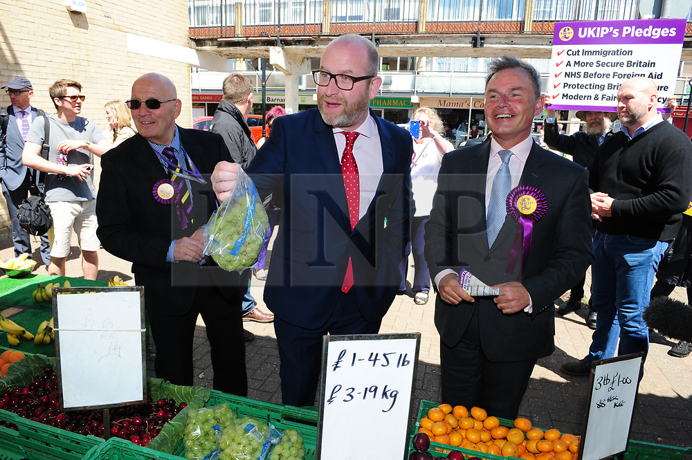© Licensed to London News Pictures. 07/06/2017<br /> Paul Nuttall buying a bag of white seedless grapes on walk about with PETER WHITTLE UKIP Candidate for South Basildon and East Thurrock.<br /> UKIP Leader Paul Nuttall in Corrington,Essex this afternoon on a walkabout on the last day of the election campaign for 2017.<br /> Photo credit: Grant Falvey/LNP