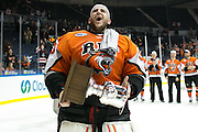 RIT goaltender Mike Rotolo, a Rochester native, celebrates after RIT defeated Robert Morris University to win the Atlantic Hockey final at the Blue Cross Arena in Rochester on Saturday, March 19, 2016.