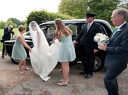 © London News Pictures. 14/09/2013.  The bride Suzanne Ashman arraigning at the church in a black cab, surrounded by bridesmaids and her father Jonathan Ashman (right). The wedding of Euan Blair, Son of former British Prime Minister Tony Blair,  to Suzanne Ashman at All Saints Parish Church in Wotton Underwood, Buckinghamshire. The wedding was attended by Former British Prime minister Tony Blair and his wife Cherie Blair. Photo credit: Ben Cawthra/LNP