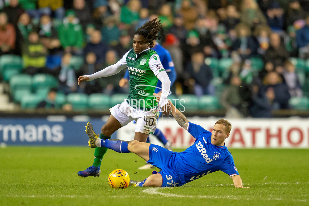 Scott Arfield (#37) of Rangers FC tackles Stephane Omeonga (#40) of Hibernan FC during the Ladbrokes Scottish Premiership match between Hibernian and Rangers at Easter Road, Edinburgh, Scotland on 8 March 2019.