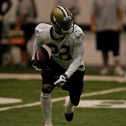 18 June 2009: Saints cornerback Tracy Porter (22) returns a punt during special teams drills during the New Orleans Saints Organized Team Activities held at the team's indoor practice facility in Metairie, Louisiana.
