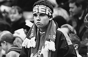 Chelsea fan with a scarf tied round his head