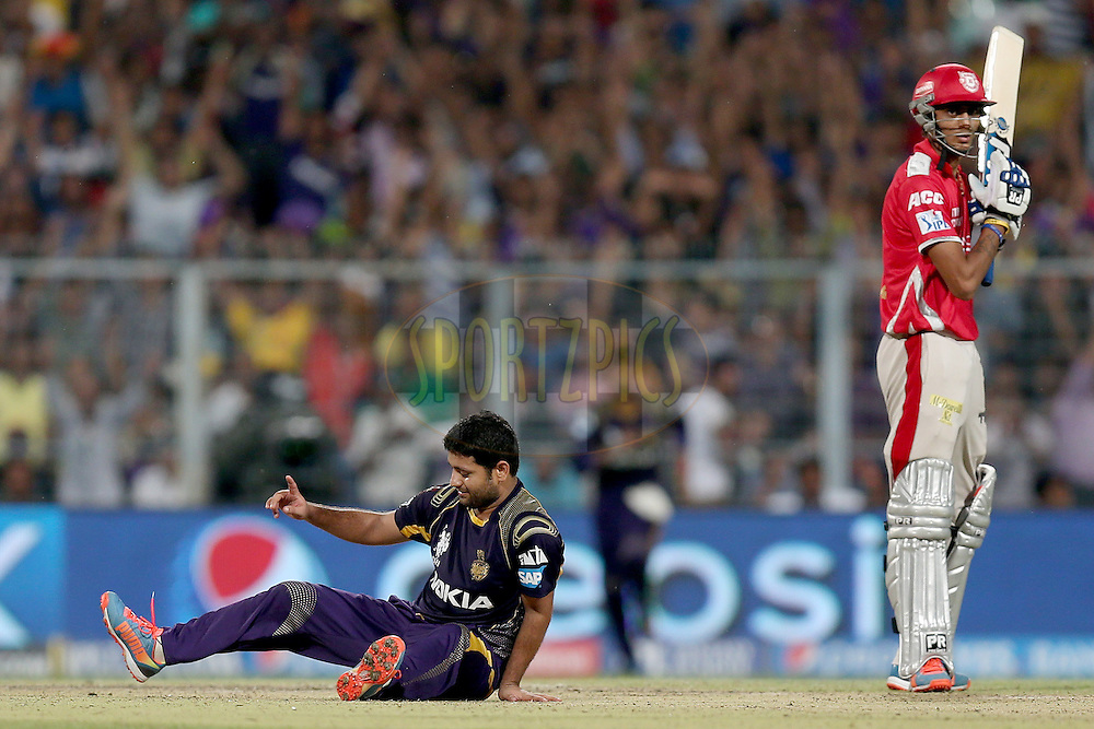 Piyush Chawla is congratulated by his teammates after taking the wicket of David Miller during the first qualifier match (QF1) of the Pepsi Indian Premier League Season VII 2014 between the Kings XI Punjab and the Kolkata Knight Riders held at Eden Gardens Cricket Stadium, Kolkata, India on the 28th May 2014. Photo by Jacques Rossouw / IPL / SPORTZPICS<br /> <br /> <br /> <br /> Image use subject to terms and conditions which can be found here:  http://sportzpics.photoshelter.com/gallery/Pepsi-IPL-Image-terms-and-conditions/G00004VW1IVJ.gB0/C0000TScjhBM6ikg