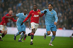 MANCHESTER, ENGLAND - Sunday, January 8, 2012: Manchester City's Joleon Lescott in action against Manchester United's Danny Welbeck during the FA Cup 3rd Round match at the City of Manchester Stadium. (Pic by David Rawcliffe/Propaganda)