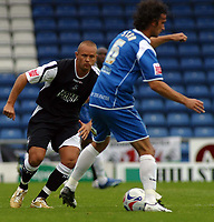 Photo: Paul Thomas.<br /> Oldham Athletic v Swansea City. Coca Cola League 1. 12/08/2006.<br /> <br /> Lee Trundle of Swansea (L) puts pressure on Stefan Stam.