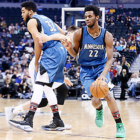 15 February 2017: Minnesota Timberwolves forward Andrew Wiggins (22) drives past Denver Nuggets forward Juancho Hernangomez (41) on a screen set by Minnesota Timberwolves center Karl-Anthony Towns (32) during the Minnesota Timberwolves 112-99 victory over the Denver Nuggets, at the Pepsi Center, Denver, Colorado, USA.