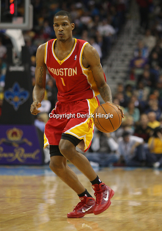 Jan 02, 2010; New Orleans, LA, USA; Houston Rockets forward Trevor Ariza (1) controls the ball against the New Orleans Hornets during a game at the New Orleans Arena. The Hornets defeated the Rockets 99-95.  Mandatory Credit: Derick E. Hingle-US PRESSWIRE
