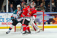 KELOWNA, CANADA - MARCH 2: Alex Swetlikoff #17 of the Kelowna Rockets is checked by Jared Freadrich #27 in front to the net of Shane Farkas #1 of the Portland Winterhawks  on March 2, 2019 at Prospera Place in Kelowna, British Columbia, Canada.  (Photo by Marissa Baecker/Shoot the Breeze)