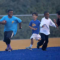 Adam Robison | BUY AT PHOTOS.DJOURNAL.COM<br /> Kevan Ford, 11, plays a game of football with friends before the start of the Tupelo DeSoto Central game Friday night in Tupelo.