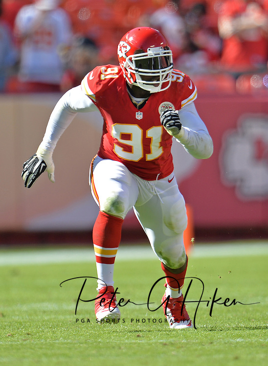 KANSAS CITY, MO - SEPTEMBER 29:  Linebacker Tamba Hali #91 of the Kansas City Chiefs rushes against the New York Giants during the first half on September 29, 2013 at Arrowhead Stadium in Kansas City, Missouri.  (Photo by Peter G. Aiken/Getty Images) *** Local Caption *** Tamba Hali