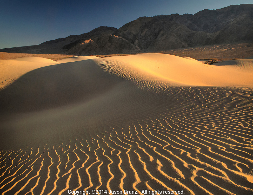 Late afternoon shadows on the Mesquite sand dunes, Death Valley National Park, California.