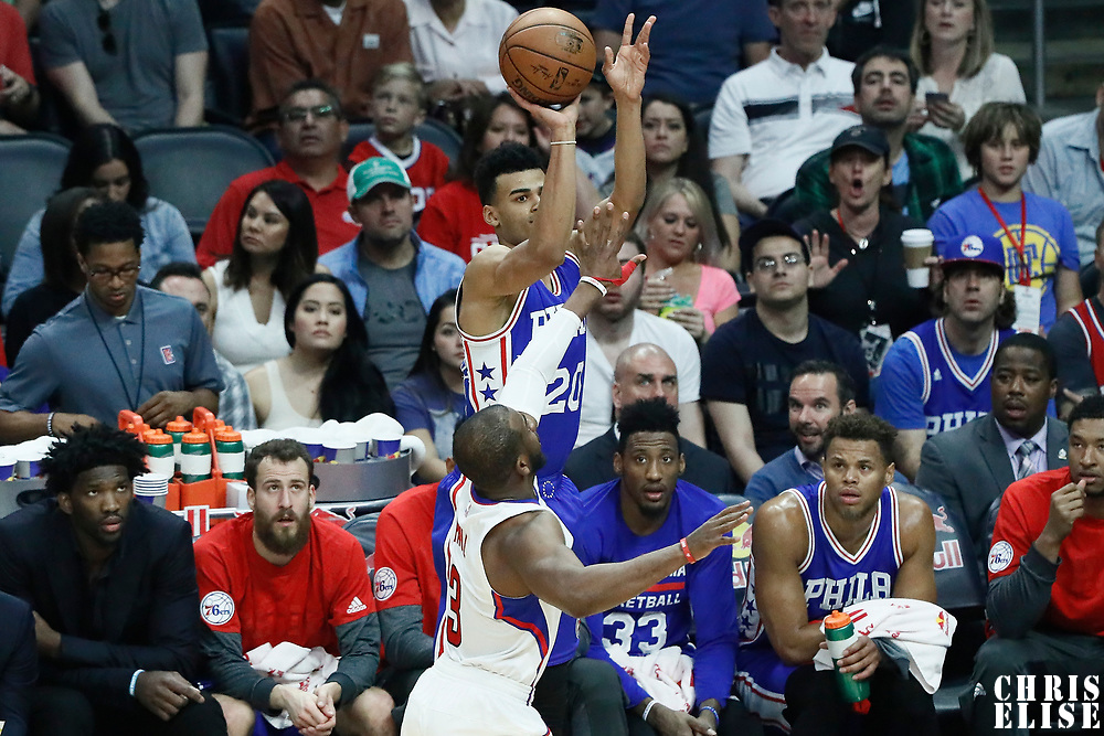 11 March 2017: Philadelphia 76ers guard Timothe Luwawu-Cabarrot (20) takes a jump shot over LA Clippers guard Chris Paul (3) during the LA Clippers 112-100 victory over the Philadelphia Sixers, at the Staples Center, Los Angeles, California, USA.