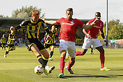 Coventry City defender Aaron Martin blocks an attempt from Burton Albion defender Tom Naylor during the Sky Bet League 1 match between Burton Albion and Coventry City at the Pirelli Stadium, Burton upon Trent, England on 6 September 2015. Photo by Simon Davies.
