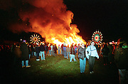 One of the biggest bonfires in the UK is lit in the remembrance of the gun powder plot, also in the background you can see a great fun fair.