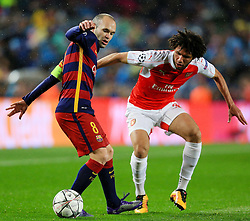 Andres Iniesta of Barcelona and Arsenal's Mohamed Elneny  - Mandatory byline: Matt McNulty/JMP - 16/03/2016 - FOOTBALL - Nou Camp - Barcelona,  - FC Barcelona v Arsenal - Champions League - Round of 16