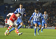 Brighton Players Tom Dallison and Robert Hunt can only watch as Daniel Crowley pulls off a Cruyff turn during the Barclays U21 Premier League match between Brighton U21 and Arsenal U21 at the American Express Community Stadium, Brighton and Hove, England on 1 December 2014.