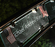 The plaque commemorating the life of Michael Andrew Bane is seen during a candlelight service to honor the victims of the attacks on the World Trade Center Sunday, September 10, 2017 at the Garden of Reflection 9/11 Memorial in Lower Makefield, Pennsylvania. (Photo by William Thomas Cain)