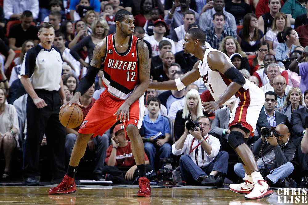 08 March 2011: Miami Heat power forward Chris Bosh (1) defends on Portland Trail Blazers power forward LaMarcus Aldridge (12) during the Portland Trail Blazers 105-96 victory over the Miami Heat at the AmericanAirlines Arena, Miami, Florida, USA.