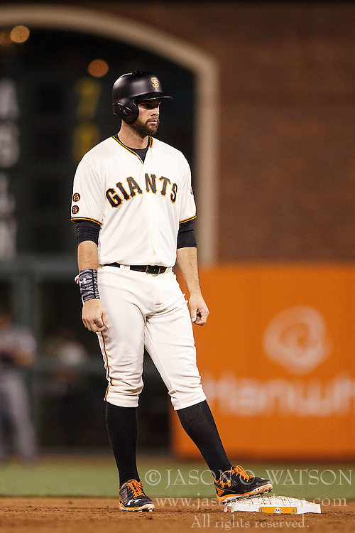 SAN FRANCISCO, CA - APRIL 18: Brandon Belt #9 of the San Francisco Giants stands on second base against the Arizona Diamondbacks during the fifth inning at AT&T Park on April 18, 2016 in San Francisco, California. The Arizona Diamondbacks defeated the San Francisco Giants 9-7 in 11 innings.  (Photo by Jason O. Watson/Getty Images) *** Local Caption *** Brandon Belt