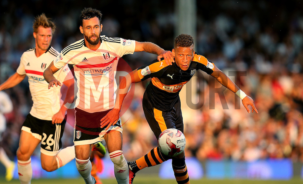 Dwight Gayle of Newcastle United heads the ball away from Michael Madl of Fulham - Mandatory by-line: Robbie Stephenson/JMP - 05/08/2016 - FOOTBALL - Craven Cottage - Fulham, England - Fulham v Newcastle United - Sky Bet Championship