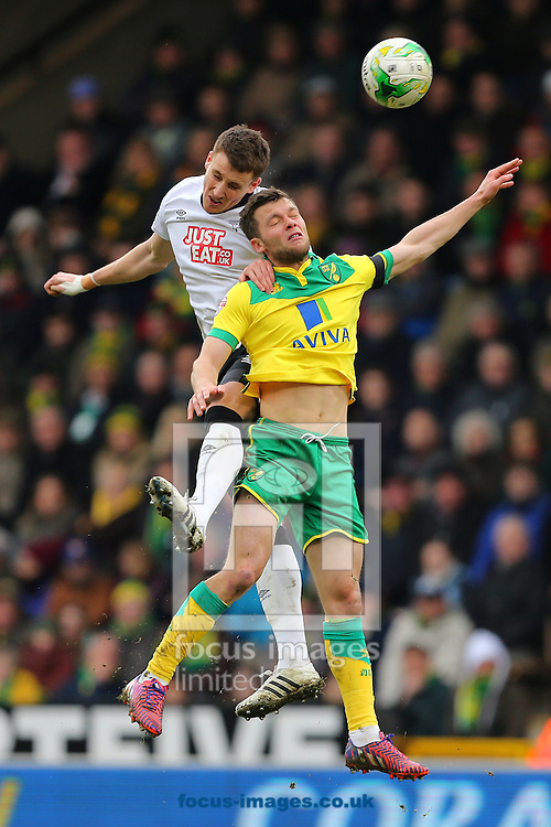 Jonathan Howson of Norwich City and Craig Forsyth of Derby County during the Sky Bet Championship match at Carrow Road, Norwich<br /> Picture by Richard Calver/Focus Images Ltd +44 7792 981244<br /> 14/03/2015