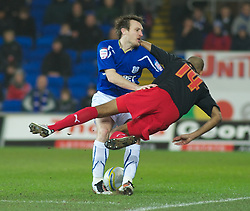 CARDIFF, WALES - Tuesday, February 1, 2011: Cardiff City's Lee Naylor fouls Reading's Jimmy Kebe during the Football League Championship match at the Cardiff City Stadium. (Photo by Gareth Davies/Propaganda)