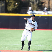 Michael Foster #12 of the Northeastern Huskies throws the ball during the game at Friedman Diamond on March 16, 2014 in Brookline, Massachusetts. (Photo by Elan Kawesch)
