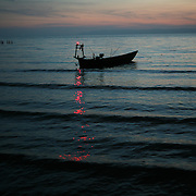 Kep Cambodia:  Sunset in Kep, a small fishing village and favorite vacation spot for Cambodians southwest of Phnom Pehn. Jose More Photography
